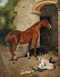A chestnut hunter with a collie and jack russell before a stable